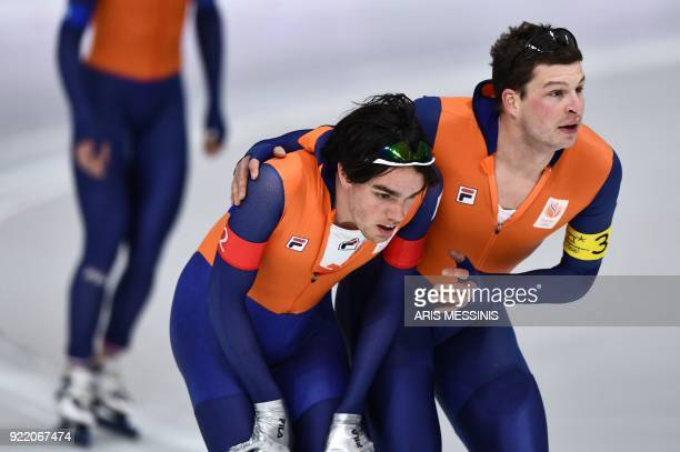 Netherlands' Patrick Roest and Netherlands' Sven Kramer react after the men's team pursuit final B speed skating event during the Pyeongchang 2018...