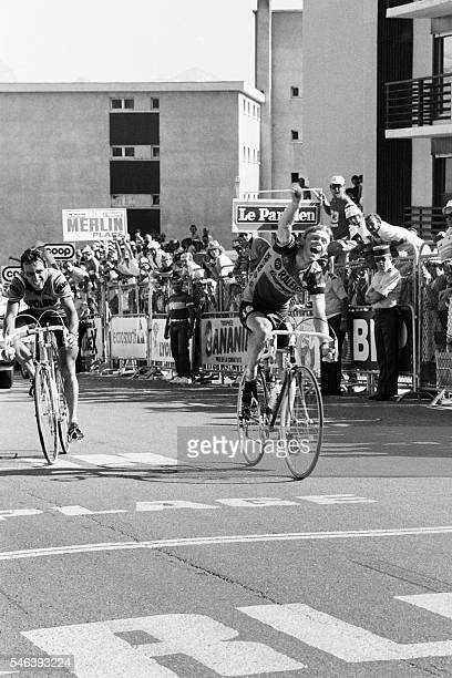 Netherland's Peter Winnen celebrates as he crosses the finish line ahead of France's Jean-Rene Bernaudeau at the end of the 17th stage of the 70th...