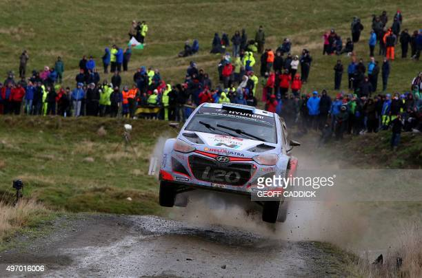 Netherlands' pilot Kevin Abbring and his British copilot Sebastian Marshall in their Hyundai i20 WRC compete in Special Stage 2 of the Wales Rally GB...