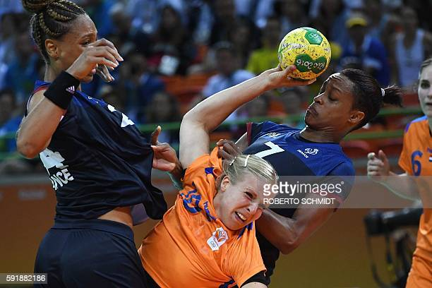 TOPSHOT Netherlands' pivot Danick Snelder vies with France's pivot Beatrice Edwige and France's left back Allison Pineau during the women's semifinal...