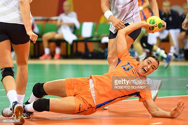 Netherlands' pivot Yvette Broch falls as she shoots during the women's Bronze Medal handball match Netherlands vs Norway for the Rio 2016 Olympics...