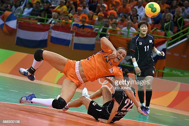 Netherlands' pivot Yvette Broch jumps to shoot during the women's preliminaries Group A handball match Netherlands vs South Korea for the Rio 2016...
