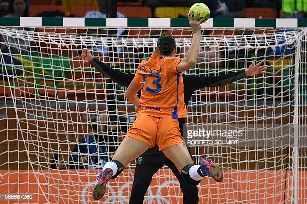 TOPSHOT Netherlands' pivot Yvette Broch takes a 7metre shoot out during the women's preliminaries Group B handball match Sweden vs Netherlands for...