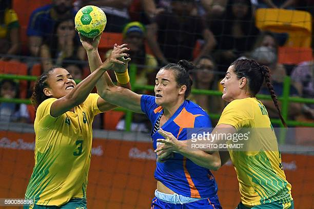 Netherlands' pivot Yvette Broch vies with Brazil's right wing Alexandra Martinez and Brazil's right wing Eduarda Amorim during the women's...
