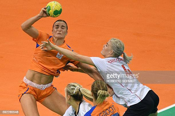 Netherlands' pivot Yvette Broch vies with Norway's left back Veronica Kristiansen during the women's Bronze Medal handball match Netherlands vs...
