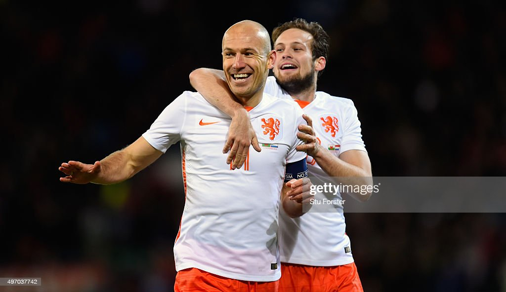 Netherlands players Arjen Robben (l) and Daley Bind celebrate the second Dutch goal during the friendly International match between Wales and Netherlands at Cardiff City Stadium on November 13, 2015 in Cardiff, Wales.