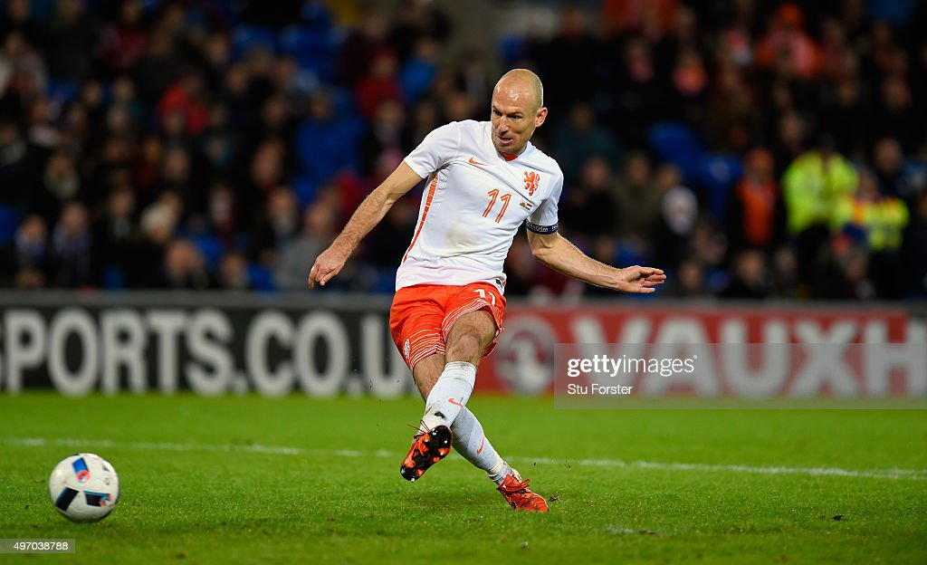 Netherlands players Arjen Robben scores the third Dutch goal during the friendly International match between Wales and Netherlands at Cardiff City Stadium on November 13, 2015 in Cardiff, Wales.