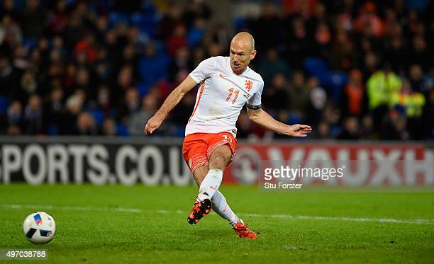 Netherlands players Arjen Robben scores the third Dutch goal during the friendly International match between Wales and Netherlands at Cardiff City...