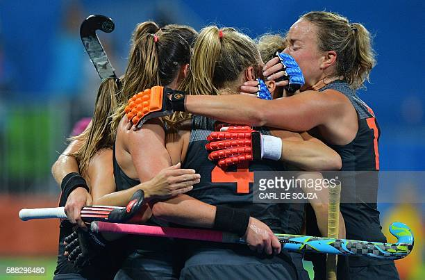 TOPSHOT Netherland's players celebrate a goal during the women's field hockey China vs Netherlands match of the Rio 2016 Olympics Games at the...