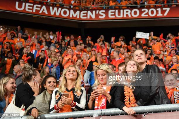 Netherlands' players celebrate after their team won the UEFA Womens Euro 2017 football tournament semifinal match between Netherlands and England at...