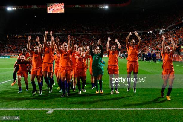 Netherlands' players celebrate after winning during the UEFA Womens Euro 2017 football tournament semi-final match between Netherlands and England at...