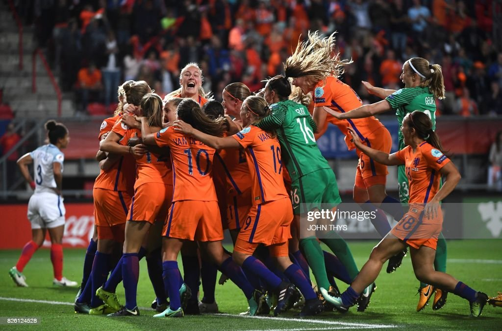 TOPSHOT - Netherlands' players celebrate after winning during the UEFA Womens Euro 2017 football tournament semi-final match between Netherlands and England at the FC Twente Stadium, in Enschede on August 3, 2017. /