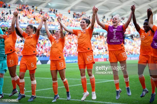 TOPSHOT Netherlands' players celebrate after winning the France 2019 Women's World Cup Group E football match between the Netherlands and Canada on...