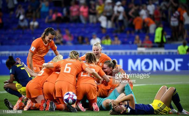 Netherlands' players celebrate after winning the France 2019 Women's World Cup semifinal football match between the Netherlands and Sweden on July 3...