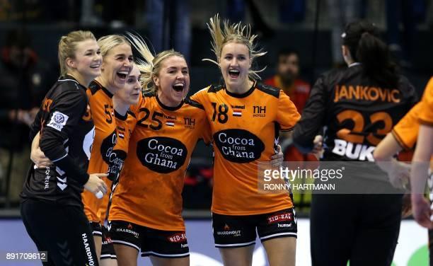 Netherland's players celebrate after winning the IHF Womens World Championship handball quater final match between Netherlands and Czech Republic on...