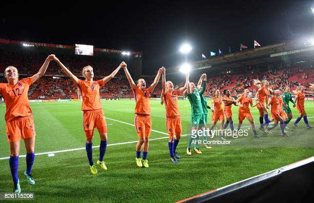 Netherlands' players celebrate after winning the UEFA Womens Euro 2017 football tournament semifinal match between Netherlands and England at the FC...