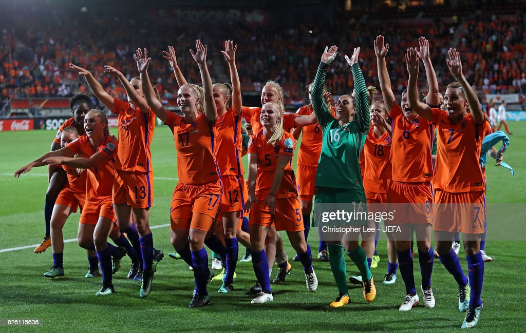 Netherlands players celebrate at the final whistle during the UEFA Women's Euro 2017 Semi Final match between Netherlands and England at De Grolsch Veste Stadium on August 3, 2017 in Enschede, Netherlands.