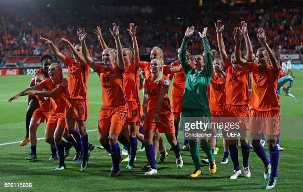 Netherlands players celebrate at the final whistle during the UEFA Women's Euro 2017 Semi Final match between Netherlands and England at De Grolsch...