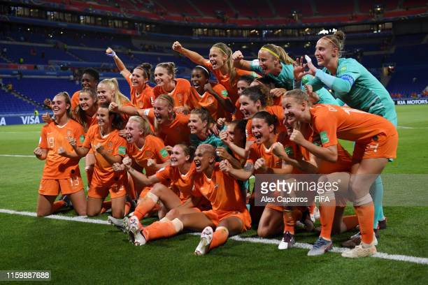 Netherlands players celebrate following their sides victory in the 2019 FIFA Women's World Cup France Semi Final match between Netherlands and Sweden...