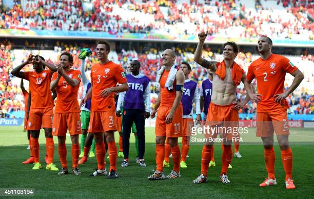 Netherlands players celebrate the 20 win after the 2014 FIFA World Cup Brazil Group B match between Netherlands and Chile at Arena de Sao Paulo on...
