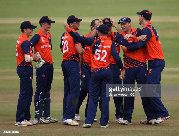 Netherlands players celebrate the wicket of Evin Lewis of The West Indies during The ICC Cricket World Cup Qualifier between The West Indies and The...