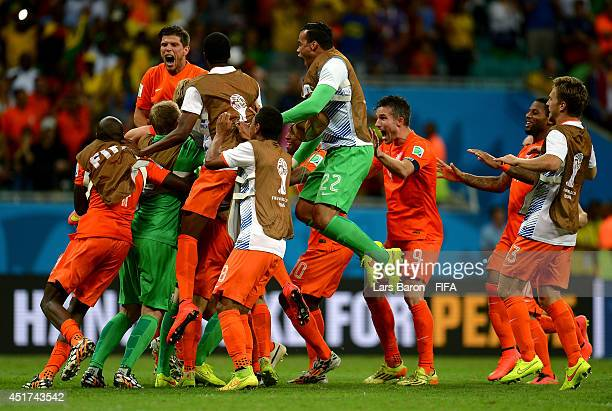 Netherlands players celebrate the win after the penalty shootout in the 2014 FIFA World Cup Brazil Quarter Final match between Netherlands and Costa...