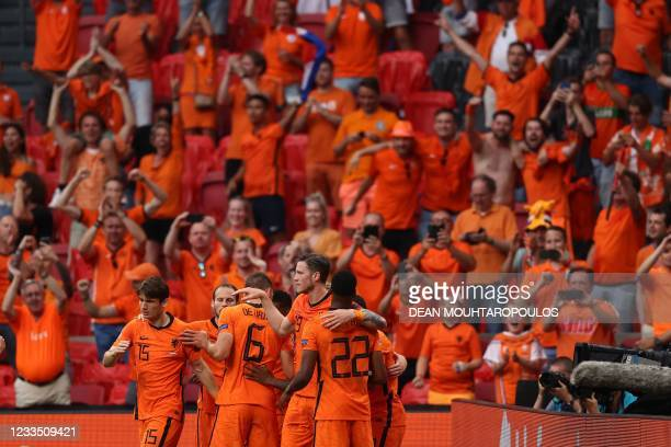 Netherland's players celebrate their opening goal scored by Netherlands' forward Memphis Depay during the UEFA EURO 2020 Group C football match...