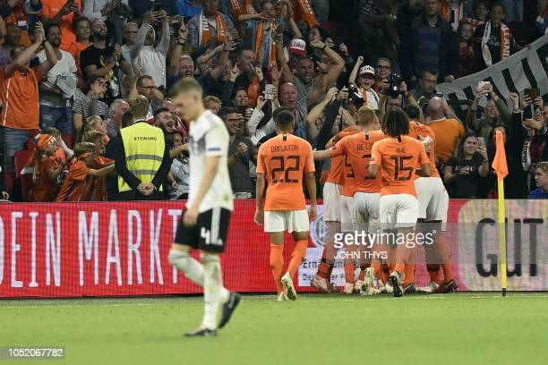 Netherlands' players celebrate their team's second goal during the UEFA Nations League football match between Netherlands and Germany on October 13...