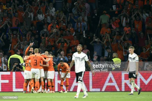 Netherlands' players celebrate their team's third goal during the UEFA Nations League football match between Netherlands and Germany on October 13...