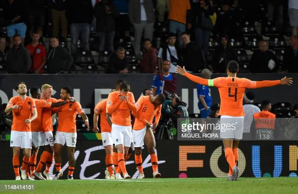 Netherlands' players celebrate their third goal during the UEFA Nations League semifinal football match between The Netherlands and England at the...