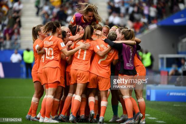 TOPSHOT Netherlands' players celebrates scoring their team's first goal during the France 2019 Women's World Cup Group E football match between the...