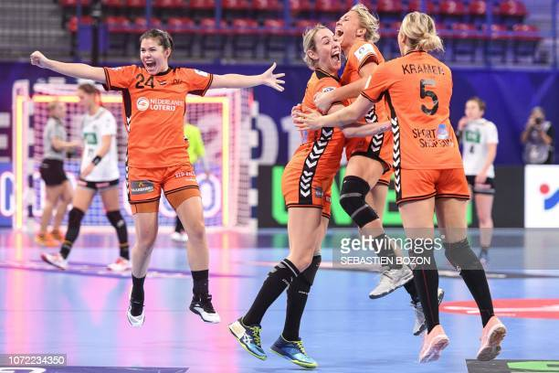 Netherlands' players jubilate at the end of the 2018 European Women's handball Championships Group 2 main round match between Netherlands and Germany...