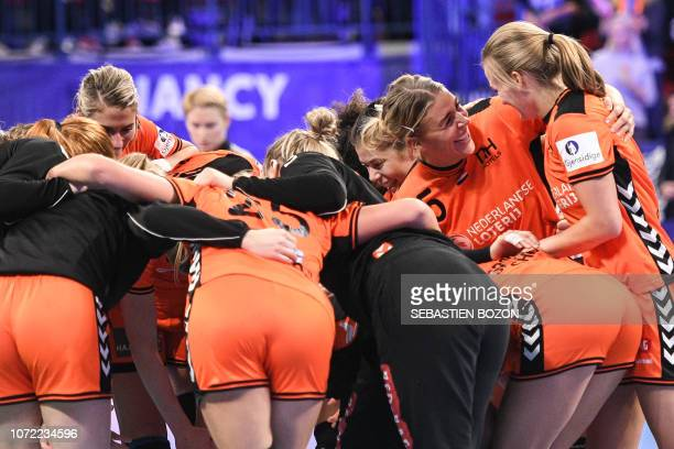 Netherlands' players jubilates at the end of the 2018 European Women's handball Championships Group 2 main round match between Netherlands and...