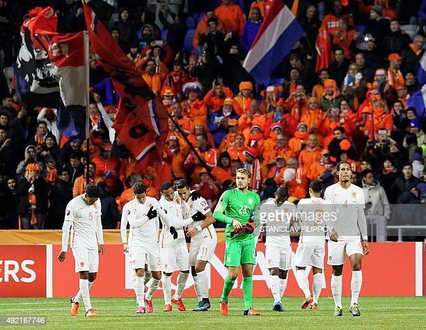 Netherland's players leave the field at the end of the Euro 2016 qualifying football match between Kazakhstan and Netherlands in Astana on October 10...