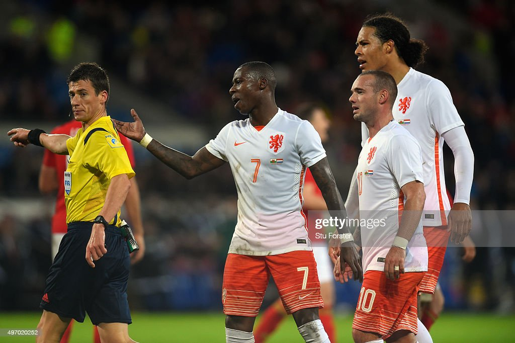 Netherlands players led by Quincy Promes (c) despute the penalty award by referee Benoit Bastien during the friendly International match between Wales and Netherlands at Cardiff City Stadium on November 13, 2015 in Cardiff, Wales.