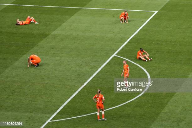 Netherlands players look dejected at fulltime after defeat in the 2019 FIFA Women's World Cup France Final match between The United States of America...