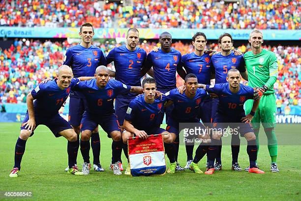 Netherlands players pose for a team photo before the 2014 FIFA World Cup Brazil Group B match between Spain and Netherlands at Arena Fonte Nova on...
