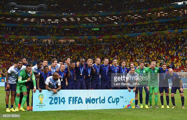 Netherlands players pose for photographs during the medal ceremony after the 2014 FIFA World Cup Brazil 3rd Place Playoff match between Brazil and...