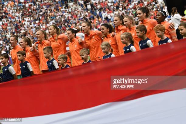 Netherlands players stand for the national anthems prior to the France 2019 Womens World Cup football final match between USA and the Netherlands, on...