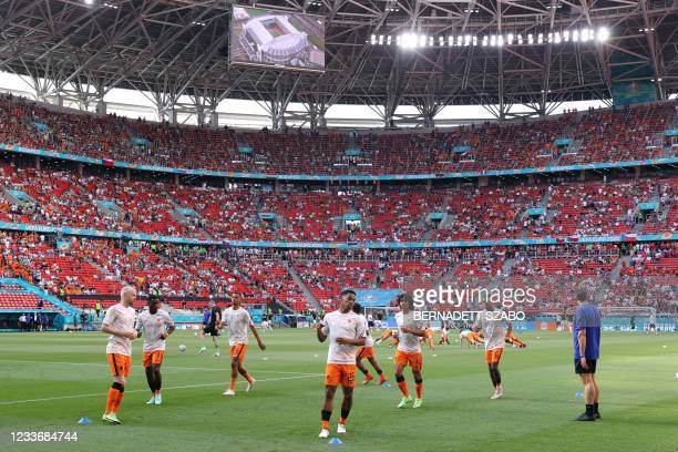 Netherlands' players warm up before the UEFA EURO 2020 round of 16 football match between the Netherlands and the Czech Republic at Puskas Arena in...