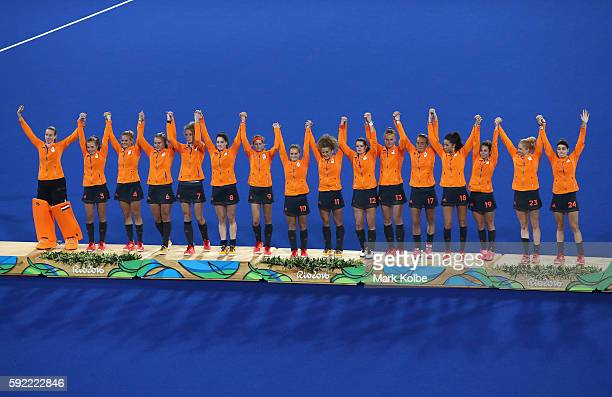 Netherlands pose on the podium during the medal ceremony after winning Silver in the Women's Hockey on Day 14 of the Rio 2016 Olympic Games at the...