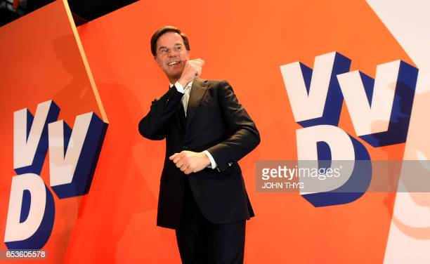 TOPSHOT Netherlands' prime minister and VVD party leader Mark Rutte arrives to deliver a speech after winning the general elections in The Hague on...