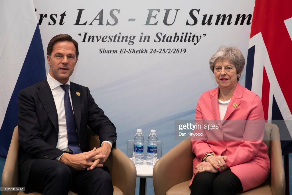 Theresa May Attends The First Arab-European Summit - Day Two : News Photo