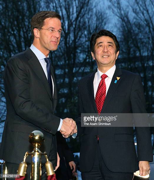 Netherlands Prime Minister Mark Rutte and Japanese Prime Minister Shinzo Abe shake hands prior to their meeting ahead of the 2014 Nuclear Security...