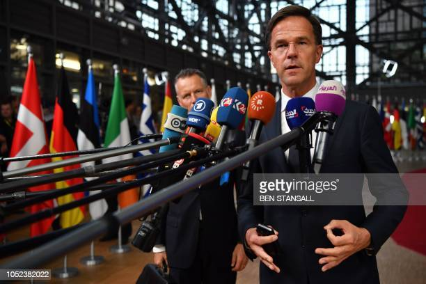 Netherlands' Prime Minister Mark Rutte answers to journalists upon his arrival at the European Council in Brussels on October 17, 2018. - British...