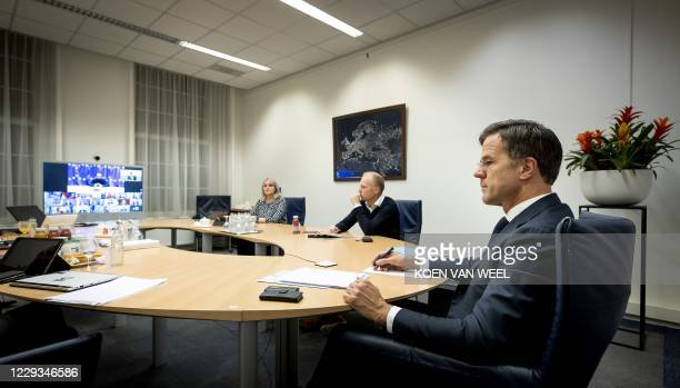 Netherlands' Prime Minister Mark Rutte looks on during a video conference with European Union leaders about the EU's approach to the coronavirus at...