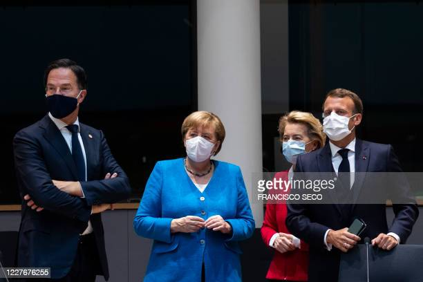TOPSHOT Netherlands' Prime Minister Mark Rutte looks on next to Germany's Chancellor Angela Merkel President of the European Commission Ursula von...