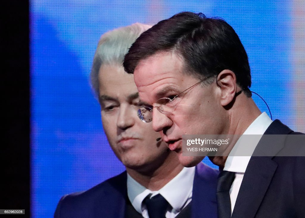 Netherlands' prime minister Mark Rutte of the VVD Liberal party (R) and Netherlands' far-right politician Geert Wilders of the PVV party look on following a debate on March 13, 2017 in Rotterdam, prior to March 15 Dutch parliamentary elections. /