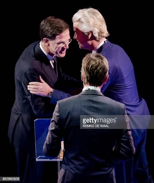 Netherlands' prime minister Mark Rutte of the VVD Liberal party and Netherlands' farright politician Geert Wilders of the PVV party shake before a...