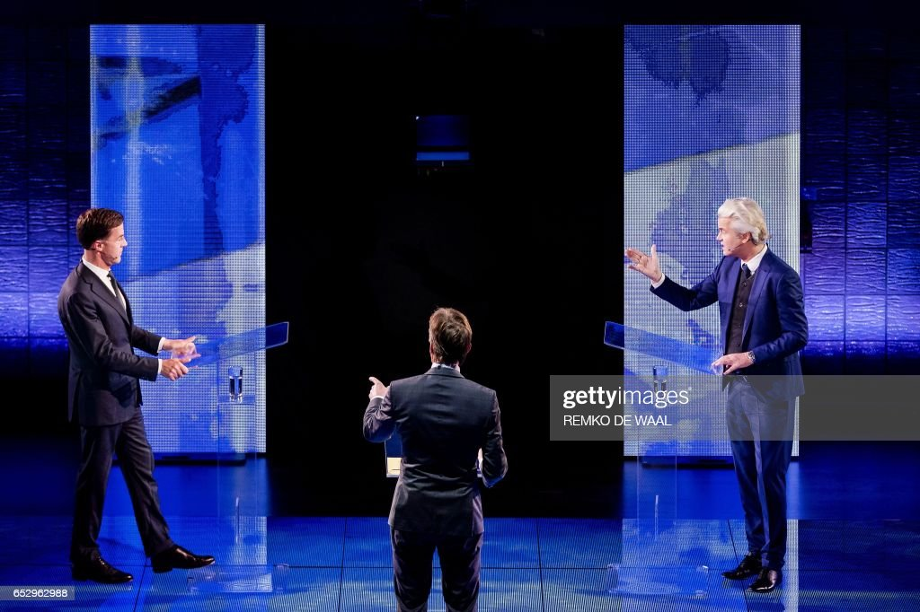 Netherlands' prime minister Mark Rutte of the VVD Liberal party (L) and Netherlands' far-right politician Geert Wilders of the PVV party debate on March 13, 2017 in Rotterdam, prior to March 15 Dutch parliamentary elections. / AFP PHOTO / ANP / Remko de Waal / Netherlands OUT